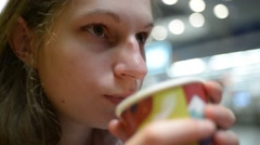 Girl drinks tee with paper cup Stock Footage