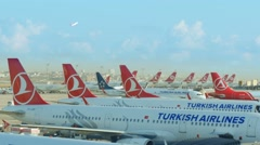 Row of turkish airlines aeroplane jetplane boing at the airport Stock Footage