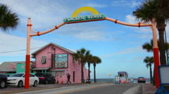Flagler Avenue cars driving down road to beach in New Smyrna Beach Florida Stock Footage