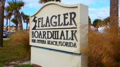 Flagler Boardwalk sign in New Smyrna Beach Florida Stock Footage