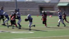 2745 - youth football, PeeWee, Pop Warner, run left, nowhere to go - stock footage
