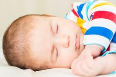 Stock Photo of Small baby in childhood concept