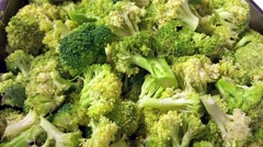 Large pile of green brassica oleracea, broccoli vegetables, at a restaurant k Stock Footage