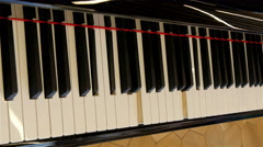 PIano keys are moving without anyone playing it Stock Footage