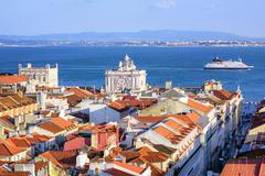 View over the roofs of downtown Lisbon to Tagus river, Portugal - stock photo