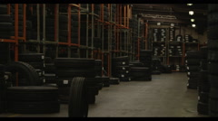 tire rolling through storage room - stock footage