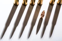 Macro shot of bullet casings on a white studio background - stock photo