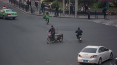 shanghai city day light traffic street bicycle riders china - stock footage