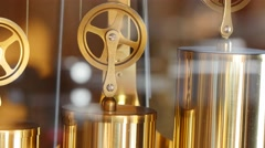 Closeup of slow dolly shot of pendulum on grandfather clock Stock Footage