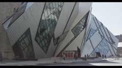 Traffic passes Royal Ontario Museum Stock Footage
