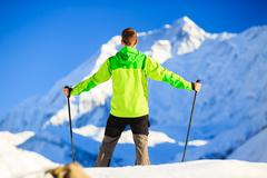 Man hiking in Himalaya Mountains in Nepal - stock photo