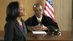 A black female attorney pleading her case before a jury Arkistovideo