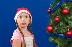 The girl costs at a fir-tree and longs - stock photo