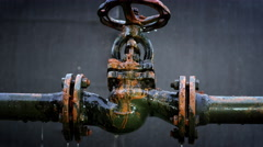 Water leaking from old rusty water supply pipe control valve assembly Stock Footage