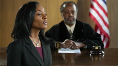 Black female attorney pleading her case to jury, close up Arkistovideo