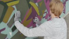 Street artist spraying colorful graffiti on the wall, close up, image, picture. Stock Footage