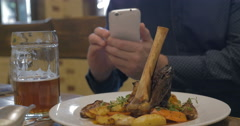 Man with phone making photo of a served dish Stock Footage