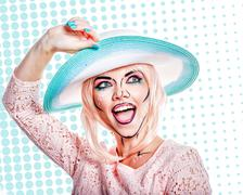 Girl in hat with makeup in the style of pop art. - stock photo