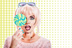 Girl with makeup in the style of pop art and lollipop. Color background - stock photo