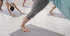 Yoga class multi racial group of women exercising fitness healthy lifestyle - stock footage