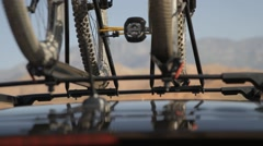 Top bike rack on vehicle with scenic mountain background Stock Footage