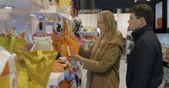 Young couple examining handbags in the store Stock Footage