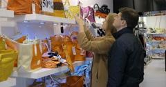 Couple choosing a handbag in the shop Stock Footage