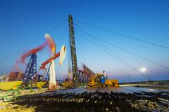 Working oil-rig of oilfield day and night Kuvituskuvat