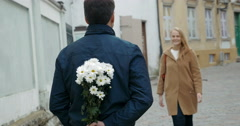 Man meeting beloved woman with flowers Stock Footage