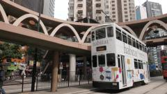 Hong Kong street view with double decker tram passing by. 4K - stock footage
