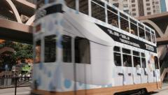 Stock Video Footage of Hong Kong street view with double decker trams passing by. 4K