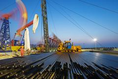 Working oil-rig of oilfield day and night Stock Photos