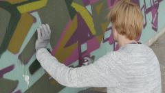 Stock Video Footage of Graffiti artist with spray painting colorful graffiti on wall,close up,artistic.