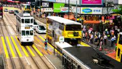 Hong Kong street view. Traffic and people on crosswalk. 4K time lapse Stock Footage
