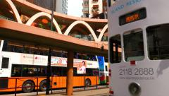Hong Kong street view with double decker tram passing by. 4K Stock Footage