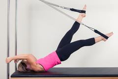Pilates aerobic instructor woman in cadillac fitness exercise Kuvituskuvat