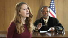 Female attorney pleading her case before a jury - stock footage