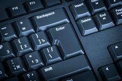 Electronic collection - close-up black computer keyboard with russian letter. - stock photo