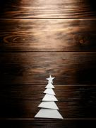 Christmas tree cut out from paper on background Stock Photos