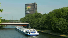 4K UHD NRW Chemical Barge passing Gasometer exhibition Hall Ruhr Area Industrial Stock Footage