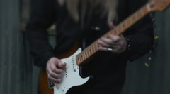 Rack focus of a guitar player Stock Footage