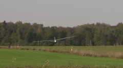 Stock Video Footage of View of glider landing at airfield