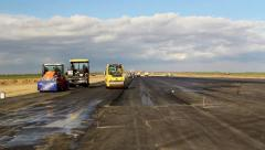 Road rollers leveling fresh asphalt pavement, time lapse - stock footage