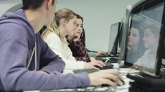 Teenage girls and boy working on computer in technology class Stock Footage