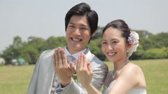 Japanese bride and groom in a city park - stock footage