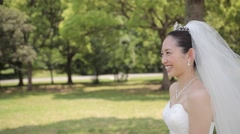 Stock Video Footage of Japanese bride and groom in a city park