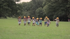 Japanese kids in a city park Stock Footage
