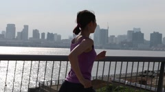 Young Japanese woman running in the city - stock footage
