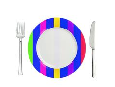 Knife, striped colorful plate and fork, isolated on white - stock photo