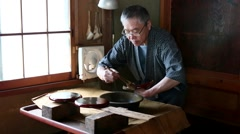 Stock Video Footage of Japanese traditional lacquerware artisan at work in his studio